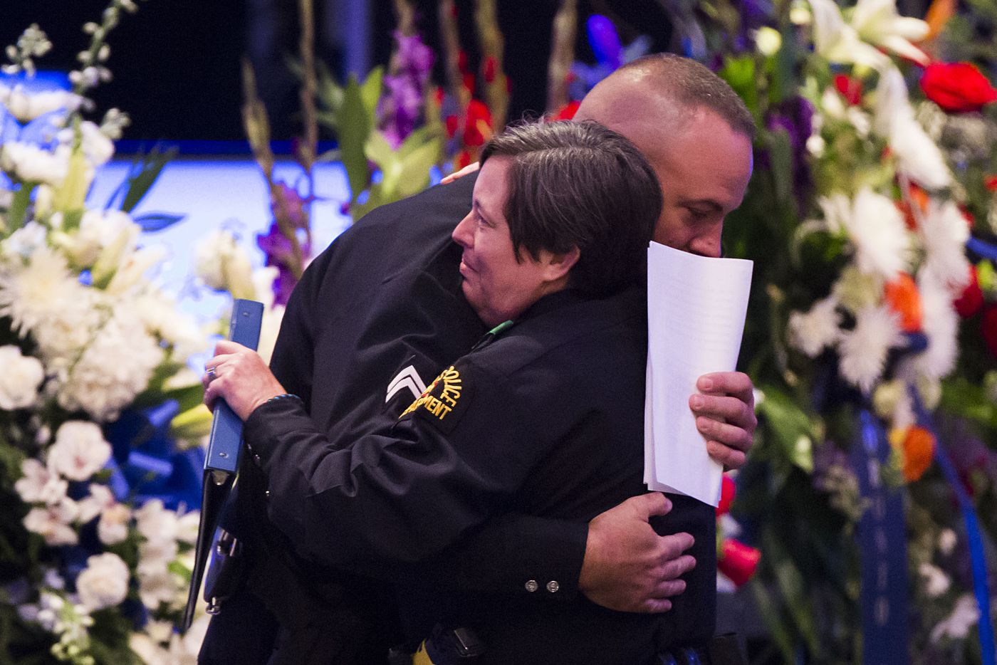 Dallas police officer Eddie Coffey hugs fellow officer Debbie Taylor during funeral services for Dallas police Sr. Cpl. Lorne Ahrens at Prestonwood Baptist Churchon Wednesday, July 13, 2016, in Plano.