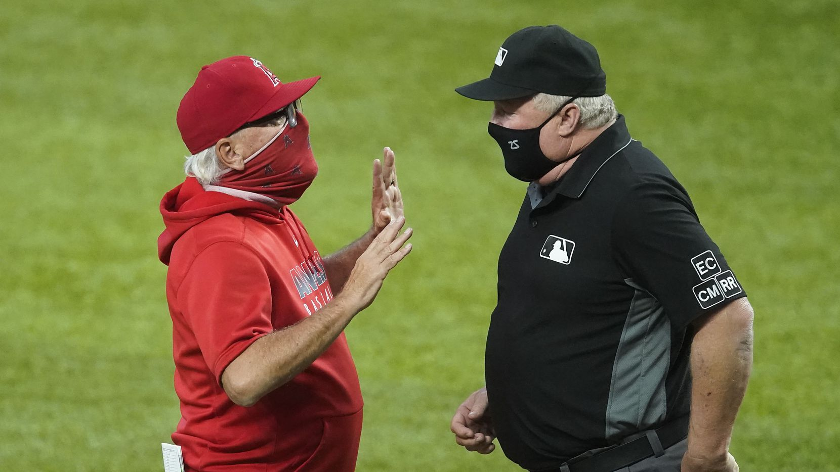 Los Angeles Angels manager Joe Maddon argues with umpire Doug Eddings after Angels center fielder Jo Adell initially looked like he was hit by a pitch, but was ruled a check swing, during the second inning against the Texas Rangers at Globe Life Field on Sunday, Aug. 9, 2020. Adell stuck out in the at bat.