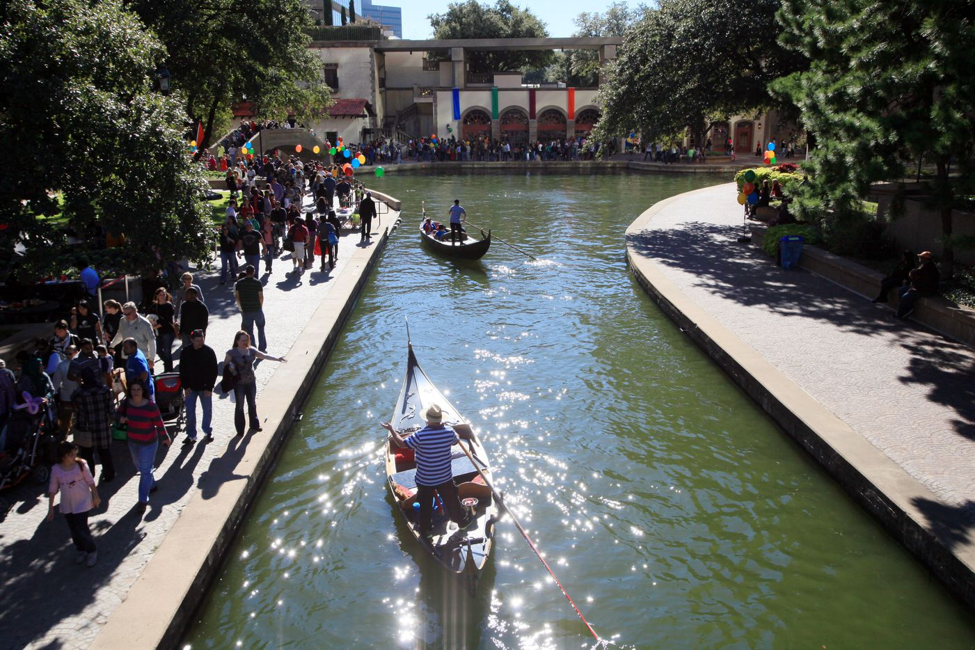 Gondolas move along the water before stopping for passengers at the revived Canal Fest, in Oct., 2013 in the Las Colinas area of Irving.