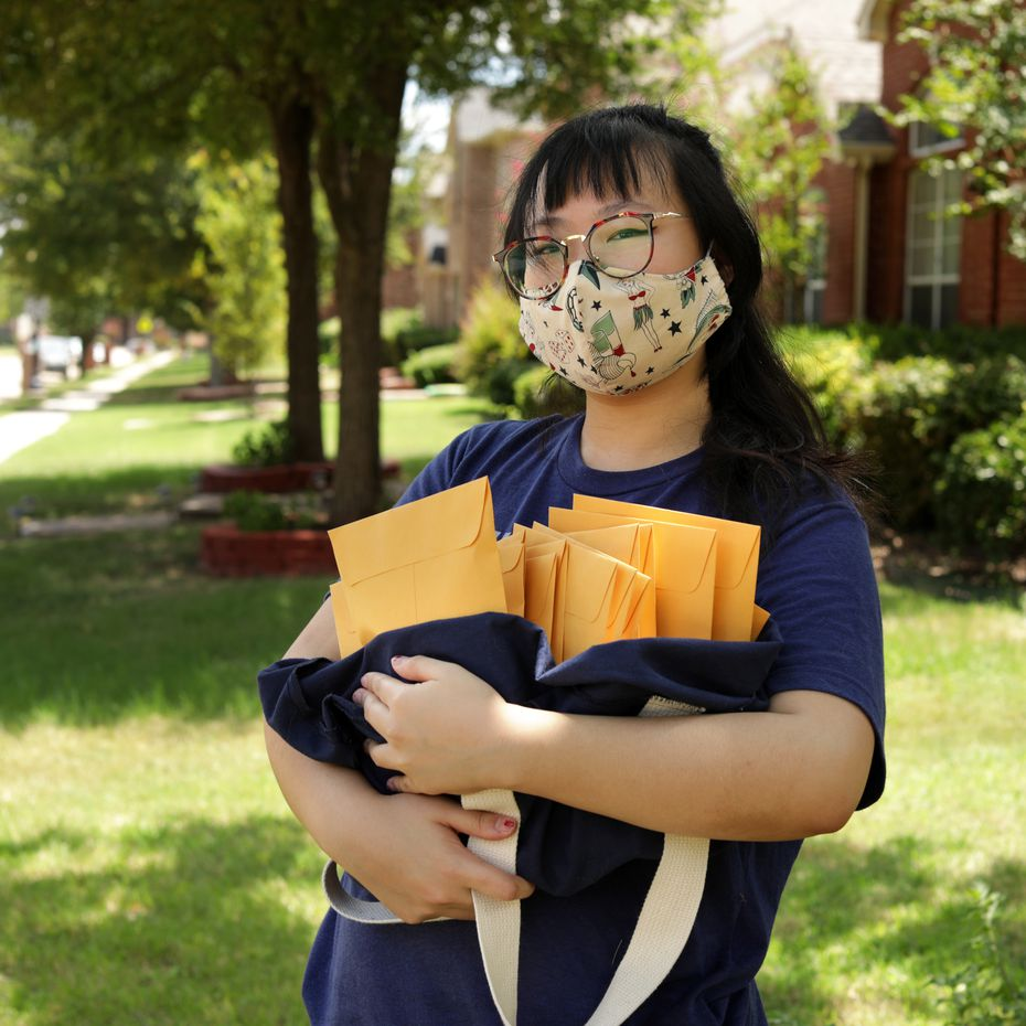 Susan Bin poses for a photograph with some packages ready to be mailed at her home in Plano on July 23.