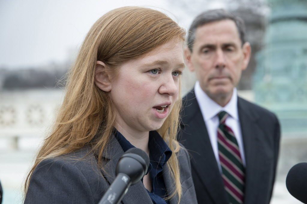 Abigail Fisher, who challenged the use of race in college admissions, was joined by lawyer Edward Blum outside the U.S. Supreme Court in December after oral arguments in the Supreme Court in her fight with the University of Texas. (J. Scott Applewhite/The Associated Press)