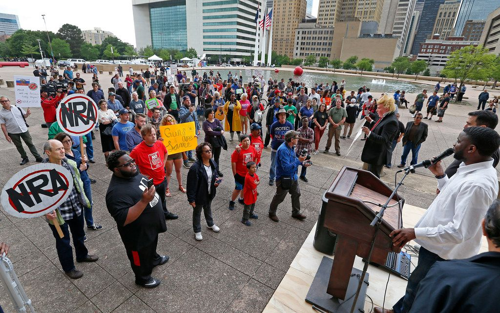 Dominique Alexander, of the Next Generation Action Network, right, speaks at a protest at City Hall Plaza near the NRA annual convention.