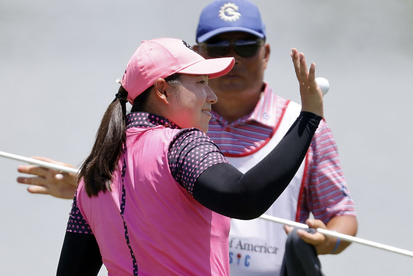 Professional golfer Min-G Kim waves to spectators after finishing her round on No. 18 during the opening round of the LPGA VOA Classic at the Old American Golf Club in The Colony, Texas, Thursday, July 1, 2021. Kim shot a 6-under. (Tom Fox/The Dallas Morning News)