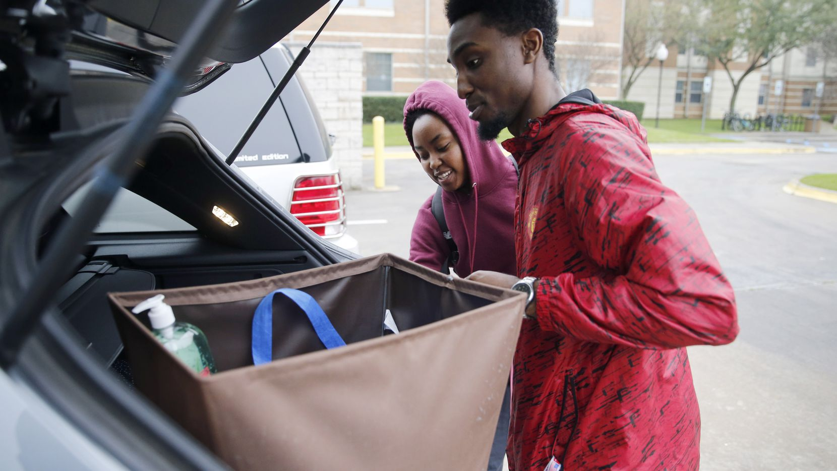 Engineering students Justin Battle and Tiara Lewis pack up items to move out Kalpana Chawla Hall at the University of Texas at Arlington on Tuesday, March 17, 2020.