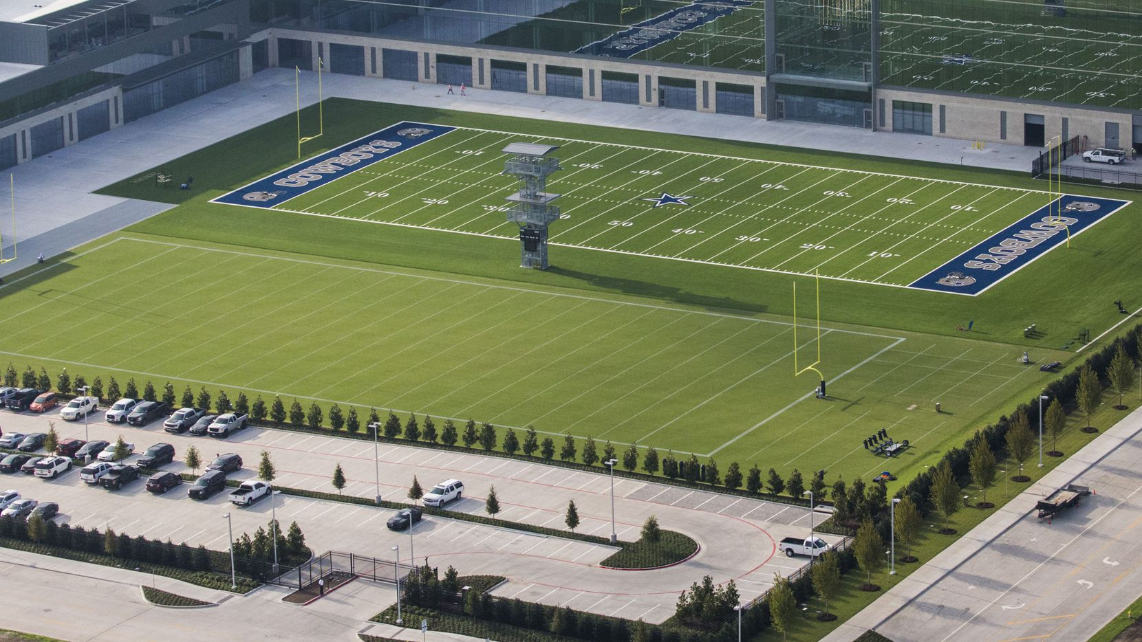 The corporate office building would be on the site which is currently used as a parking lot (lower left), directly across from the offices of the Dallas Cowboys.