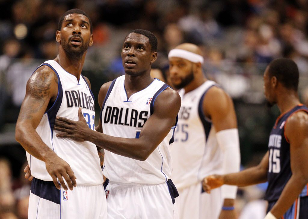 Dallas Mavericks shooting guard O.J. Mayo (32) and Dallas Mavericks point guard Darren Collison (4) during a break in play against the Charlotte Bobcats during the first half of play at American Airlines Center in Dallas, on October 26, 2012. (Vernon Bryant/The Dallas Morning News)