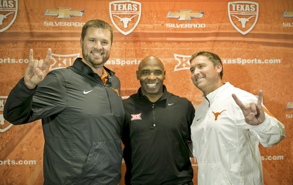 University of Texas NCAA college football head coach Charlie Strong, center, introduces two new assistant coaches, offensive line coach Mike Mattox, left, and offensive coordinator Sterlin Gilbert, during a news conference in Austin, Texas, Monday Dec. 14, 2015.