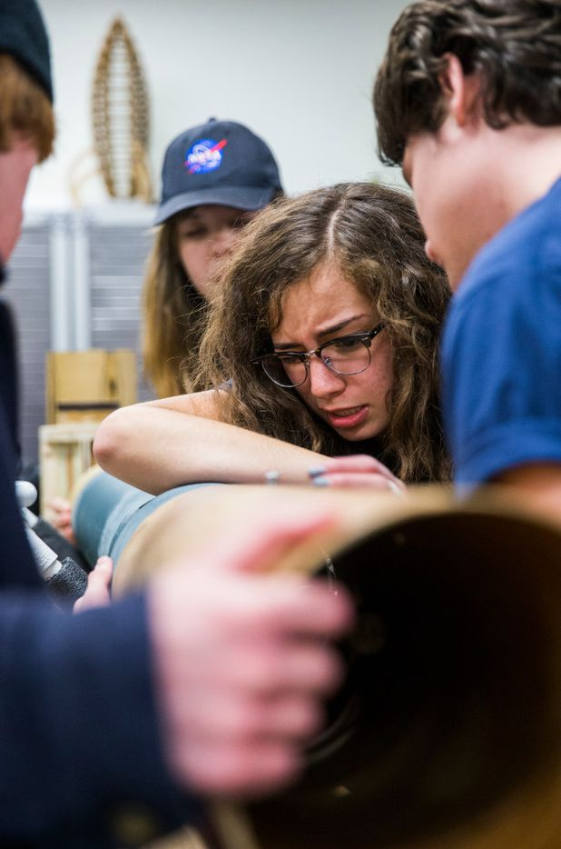 Alex Macias, 16, center, chief of safety for the McKinney High School Flying Lions Rocketry Club, helps to assemble the rocket.  In April, the students will join 17 other high school teams at NASA's Marshall Space Flight Center in Huntsville, Ala. (Ashley Landis/The Dallas Morning News)