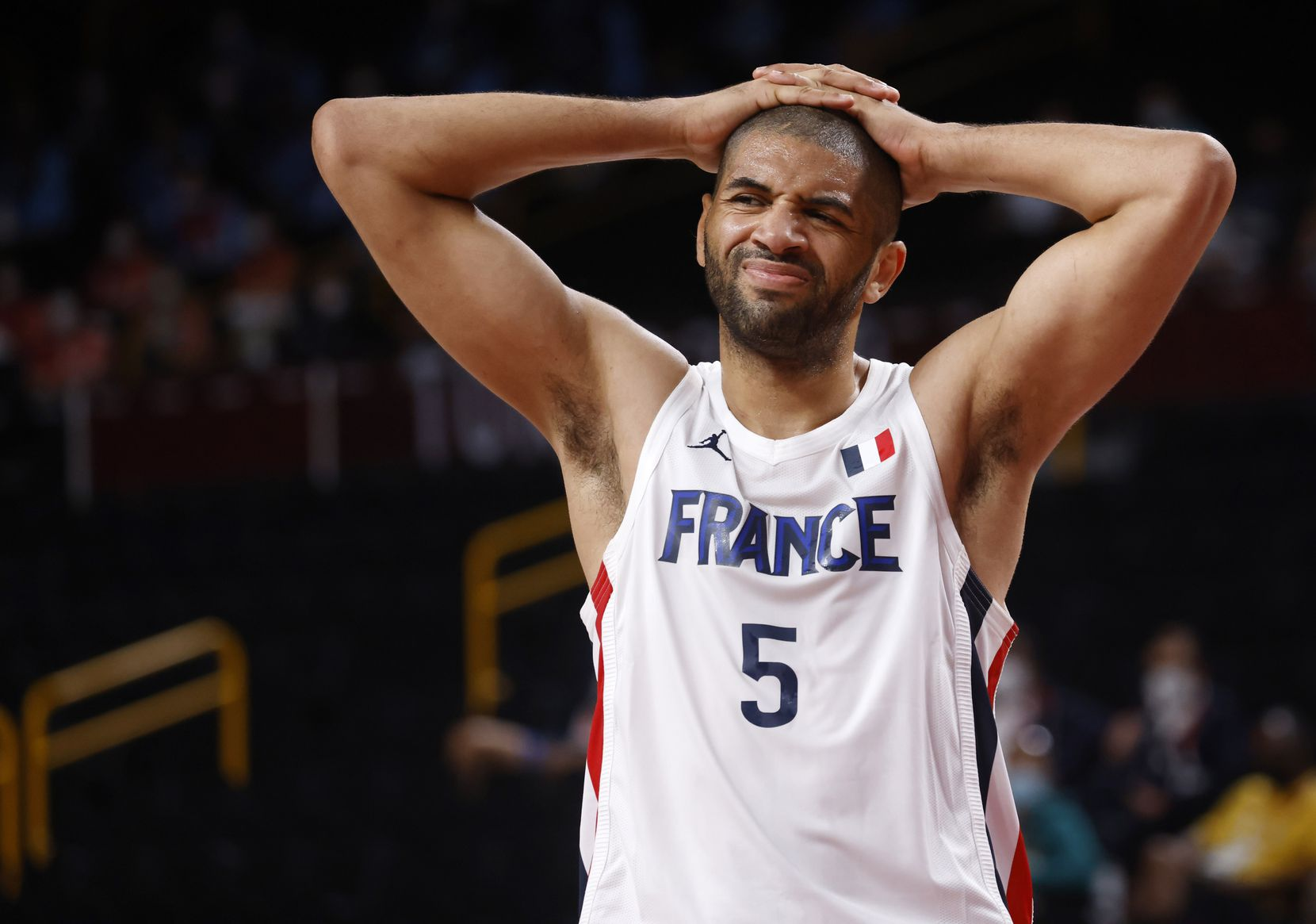 France's Nicols Batum (5) reacts to a teammate getting called for a foul in a game against Slovenia during the first half of a men's basketball semifinal at the postponed 2020 Tokyo Olympics at Saitama Super Arena, on Thursday, August 5, 2021, in Saitama, Japan. (Vernon Bryant/The Dallas Morning News)