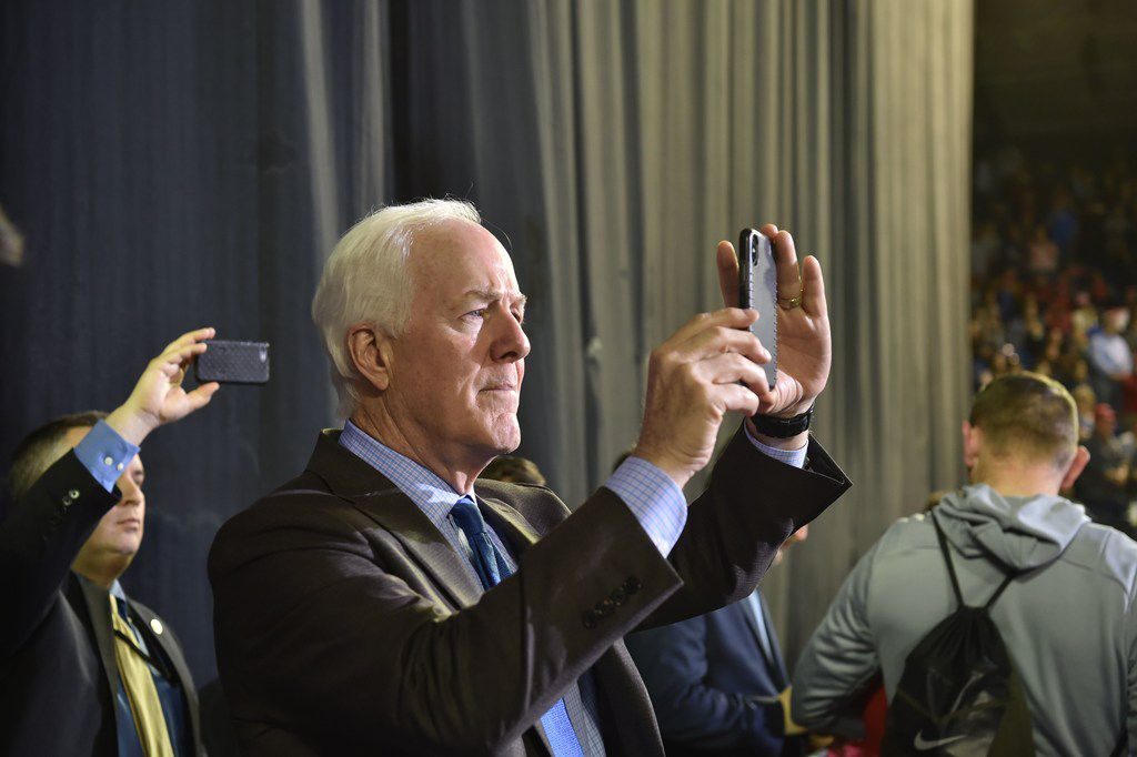 Sen. John Cornyn, R-Texas, takes a picture during President Donald Trump's rally in El Paso on February 11, 2019.