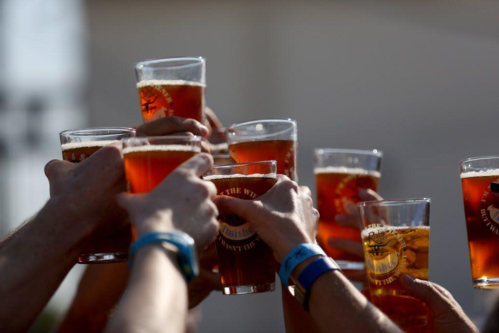 Oktoberfest celebrants raise their glasses.