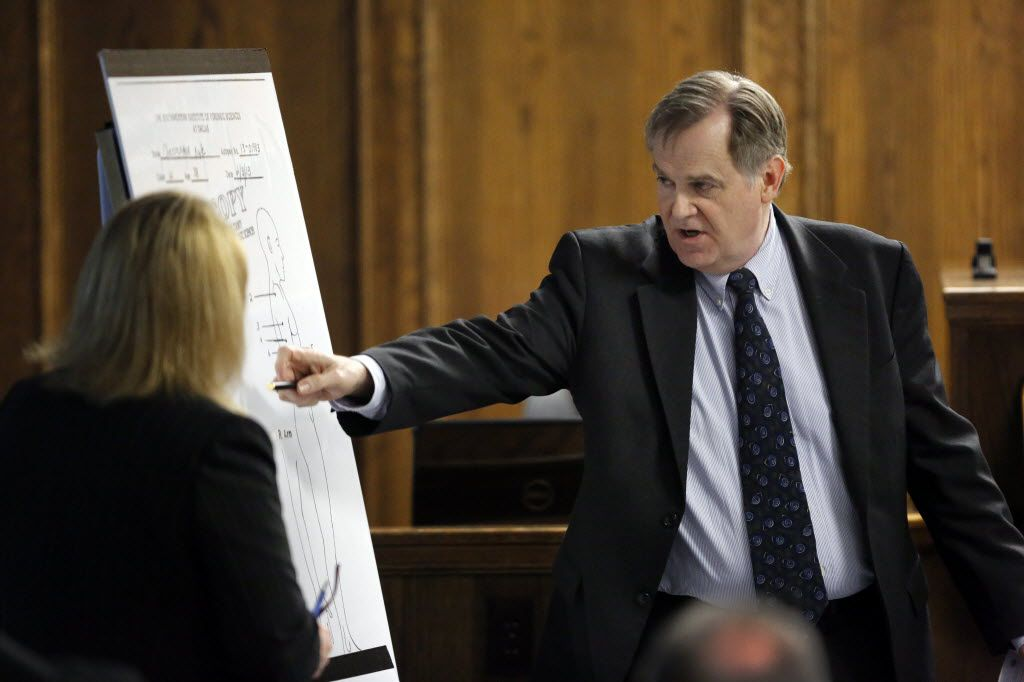 Dr. Jeffrey Barnard, Dallas County chief medical examiner pointed to where injuries from bullets during former Marine Cpl. Eddie Ray Routh's capital murder trial in Erath County in February 2015.  Routh, 27, of Lancaster killed former Navy SEAL Chris Kyle and his friend Chad Littlefield at a shooting range near Glen Rose.