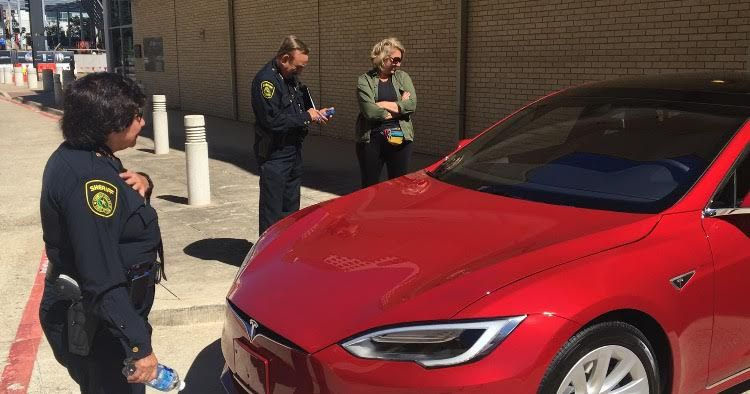 Dallas County Sheriff Lupe Valdez receives an early birthday surprise red Tesla sedan from her partner, Lindsay Browning, after an interview at The Dallas Morning News on Thursday. (Naomi Martin/Staff)