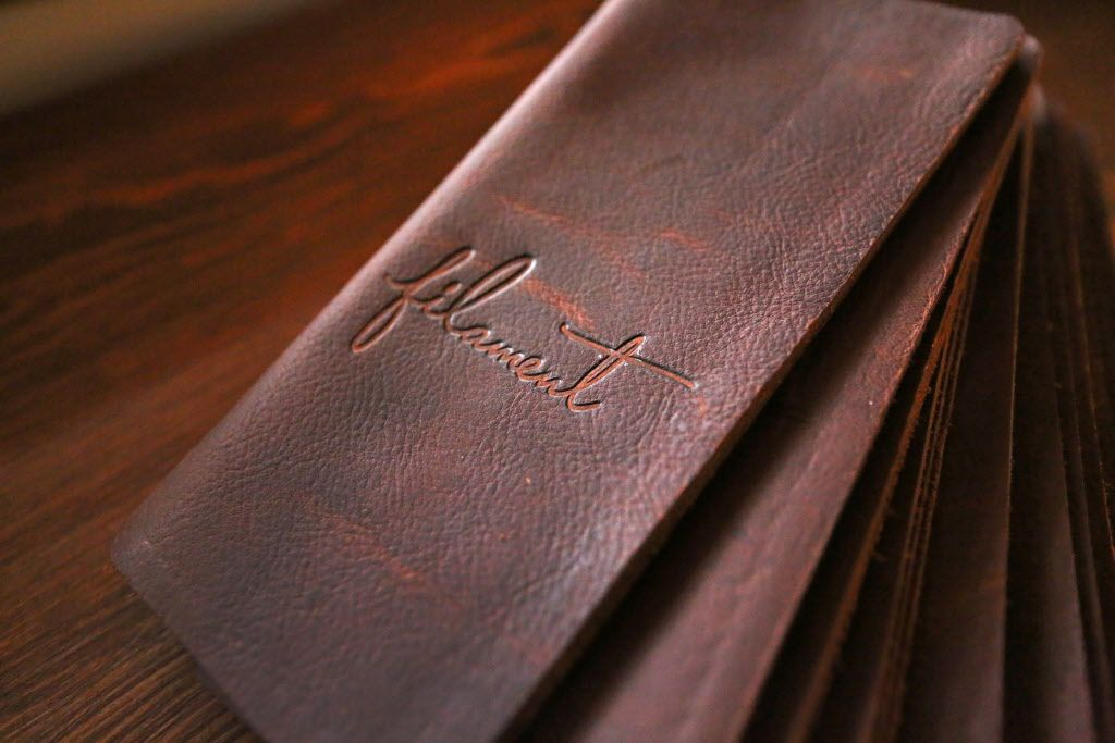 Engraved leather bill folders are some of the nice touches at the new restaurant, Filament, at 2626 Main Street in Deep Ellum in Dallas, photographed on Tuesday, December 1, 2015. (Louis DeLuca/The Dallas Morning News)