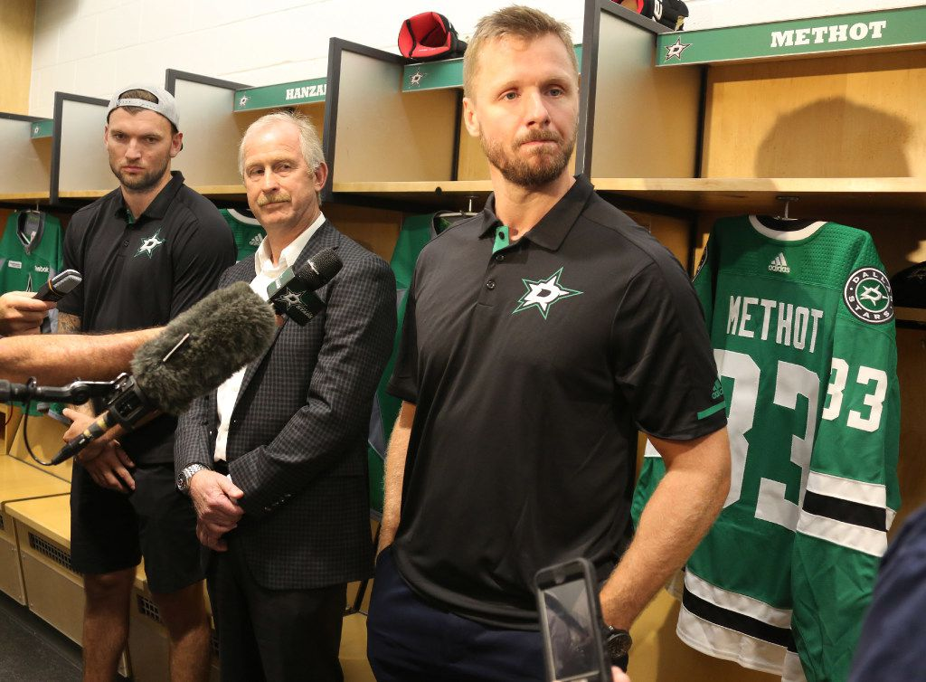 New Dallas Stars forward Martin Hanzal, left, and defenseman Marc Methot, right, talk with the media, along with Stars general manager Jim Nill, center, at the Stars' practice facility in Frisco on Tuesday, July 18, 2017. (Louis DeLuca/The Dallas Morning News)