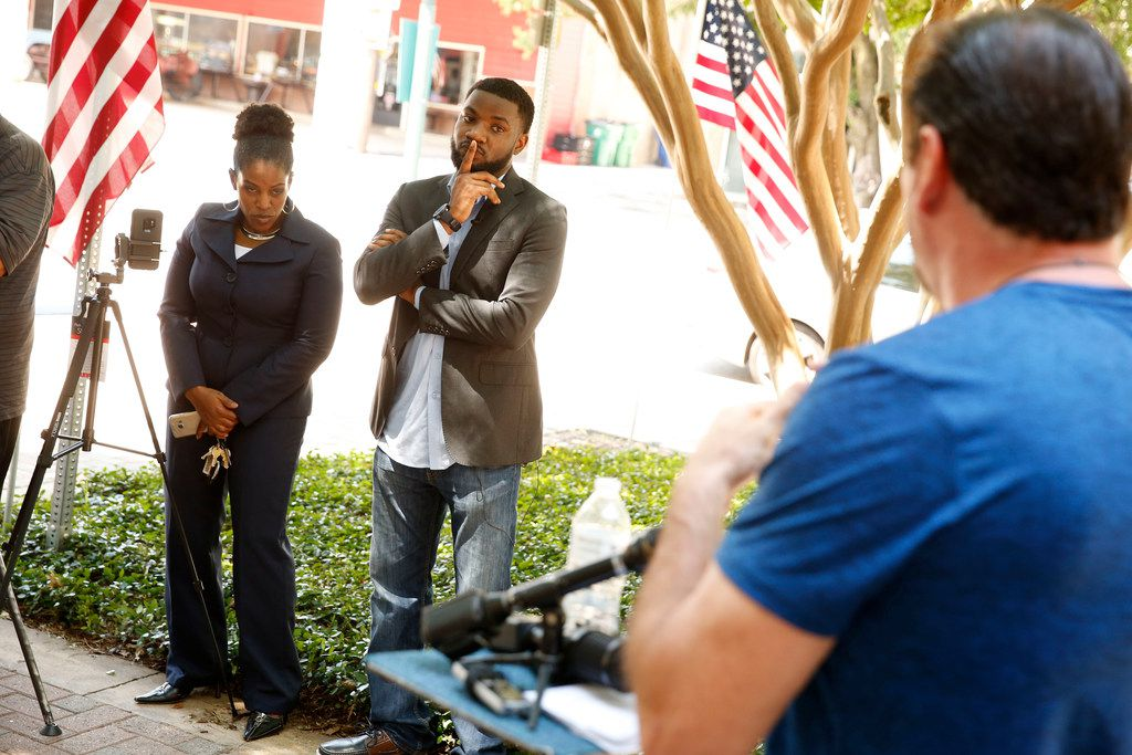 Dominique Alexander and Kim T. Cole, left, listen as McKinney Mayor George Fuller talks bout the dealings with the Craig Ranch community pool incident in front of City Hall in McKinney, Texas on May 29, 2018.