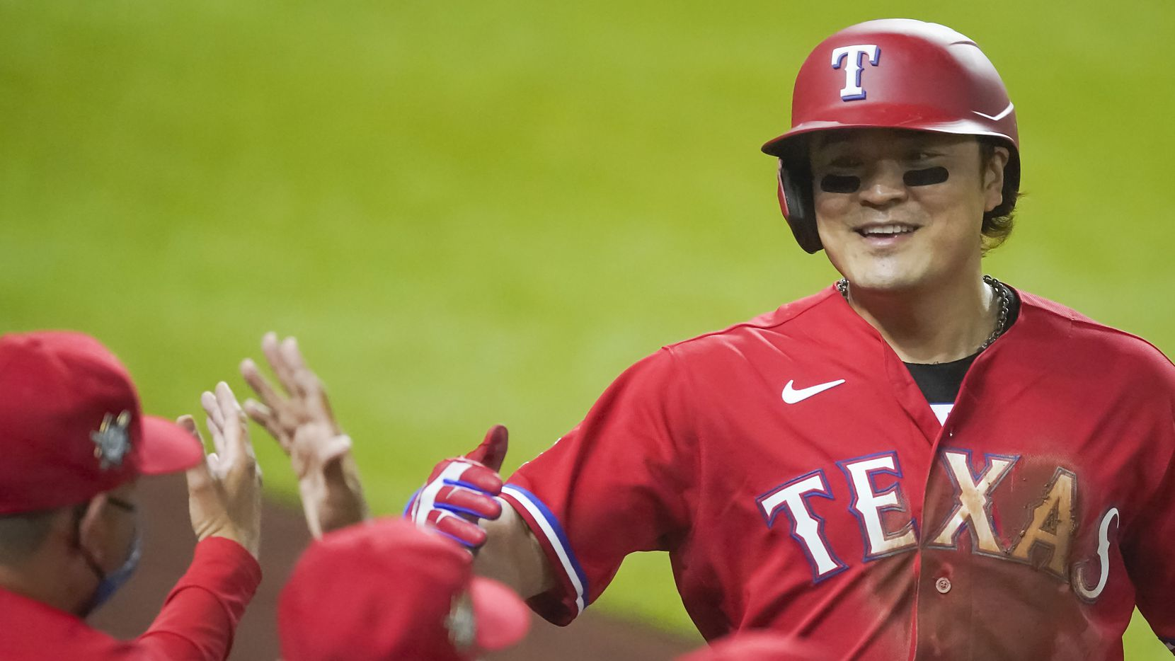 Texas Rangers designated hitter Shin-Soo Choo celebrates after scoring during the third inning against the Los Angeles Dodgers at Globe Life Field on Friday, Aug. 28, 2020.
