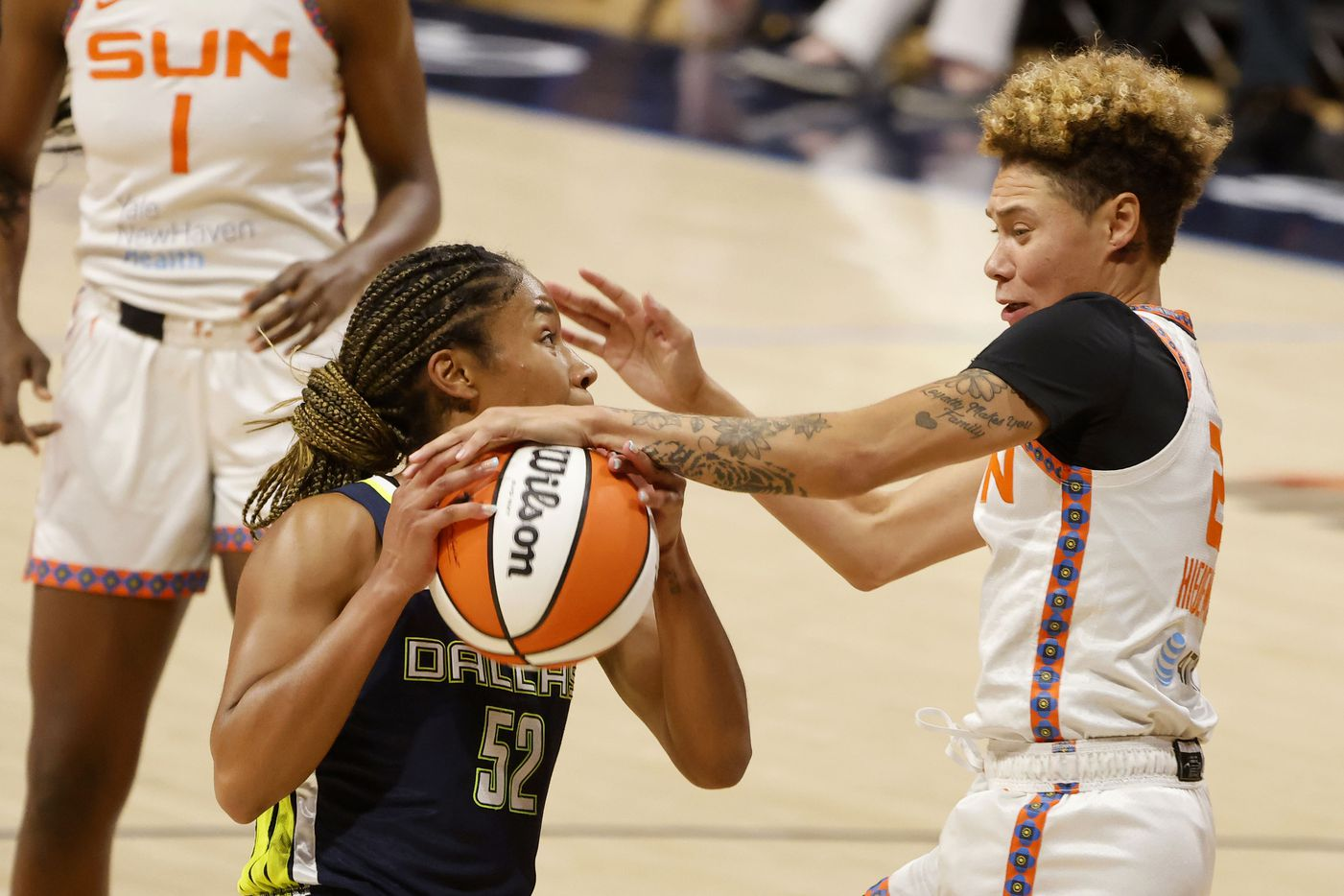 Dallas Wings guard Tyasha Harris (52) has a shot blocked by Connecticut Sun guard Briann January (20) during the second half of a WNBA basketball game in Arlington, Texas on Tuesday, Sept. 07, 2021. (Michael Ainsworth/Special Contributor)