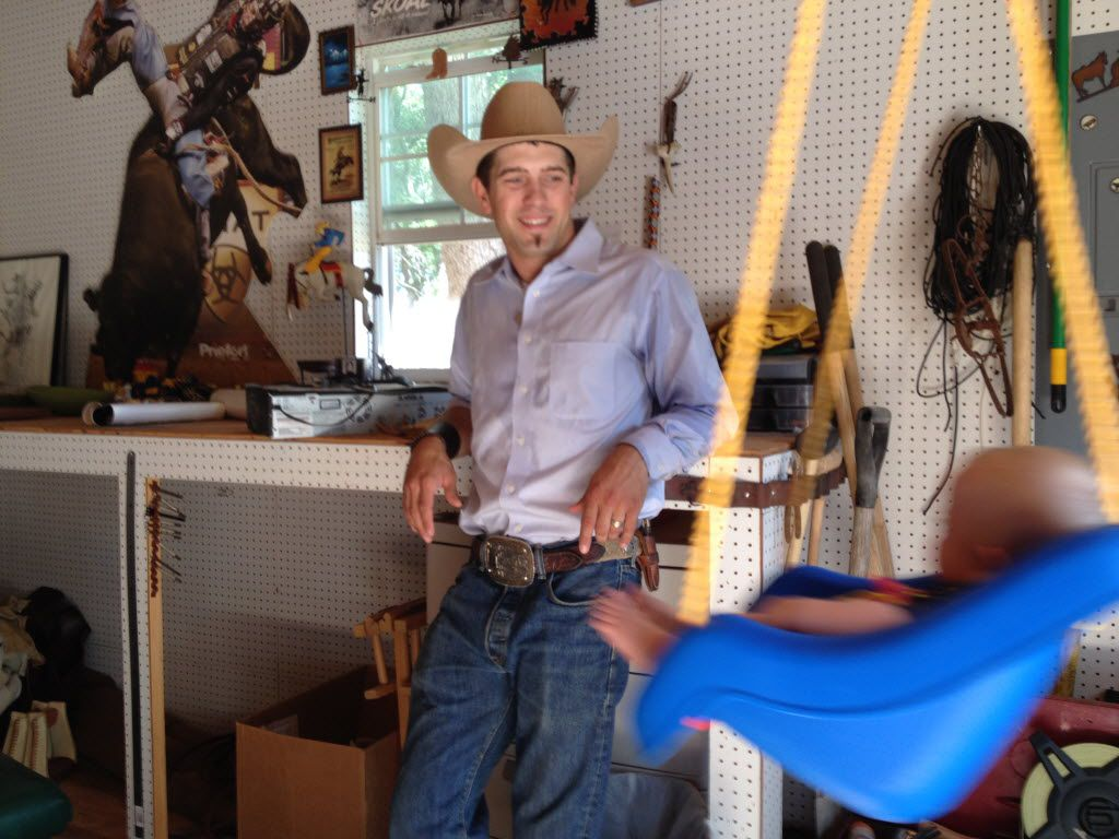 Bull Rider McKennon Wimberly plays with his six-month old son, Wilder, at his home in Millsap, Texas.