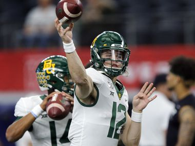 Baylor Bears quarterback Charlie Brewer (12)   warms up his arm before facing the Baylor Bears in the Big 12 Championship at AT&T Stadium in Arlington, Saturday, December 7, 2019.