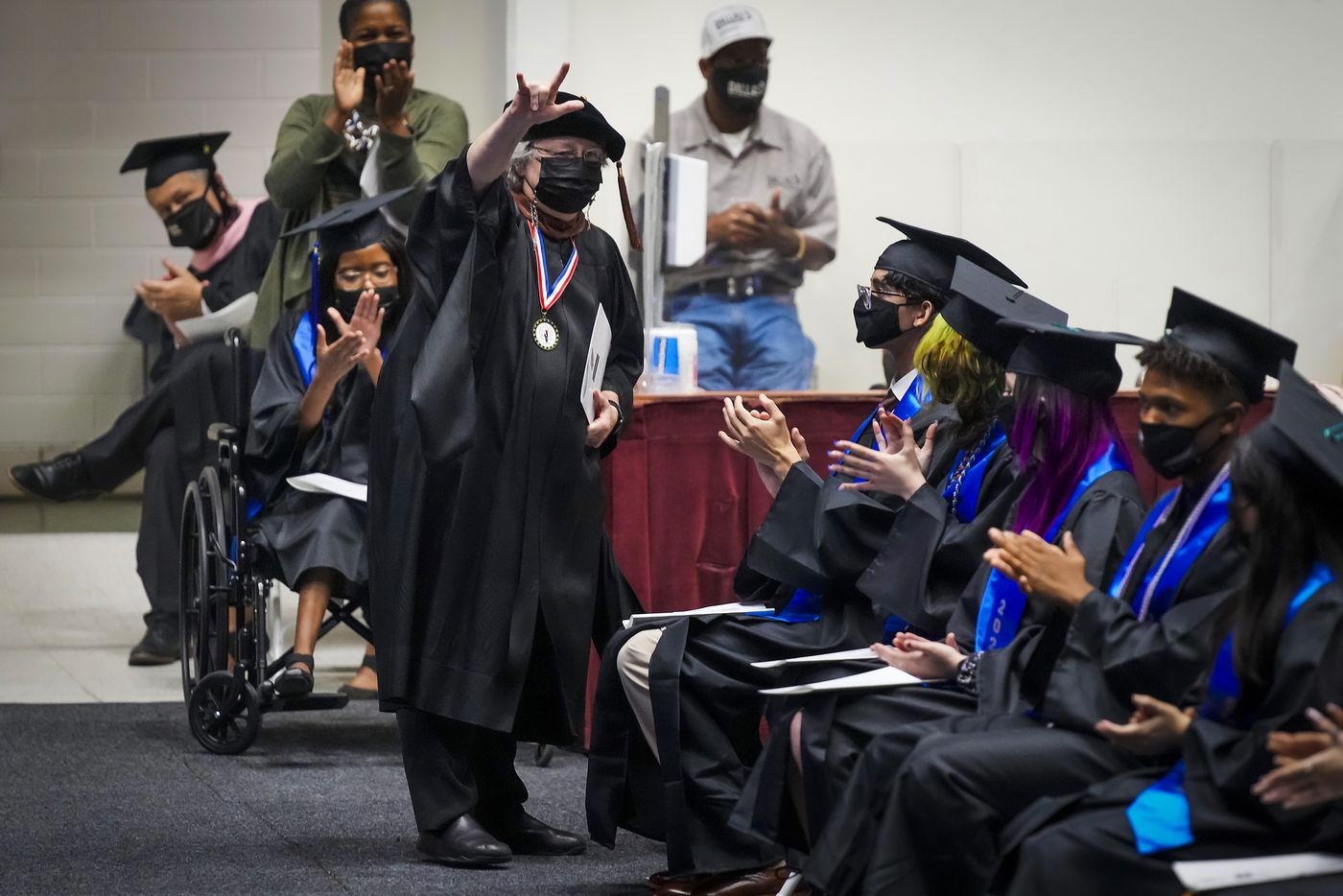 Karon Cogdill, director of the Theater Conservatory for Booker T. Washington High School for the Performing and Visual Arts, is acknowledged during commencement ceremonies for the school at Loos Field House on Saturday, June 19, 2021. Cogdill is retiring after more than 40 years at the school.