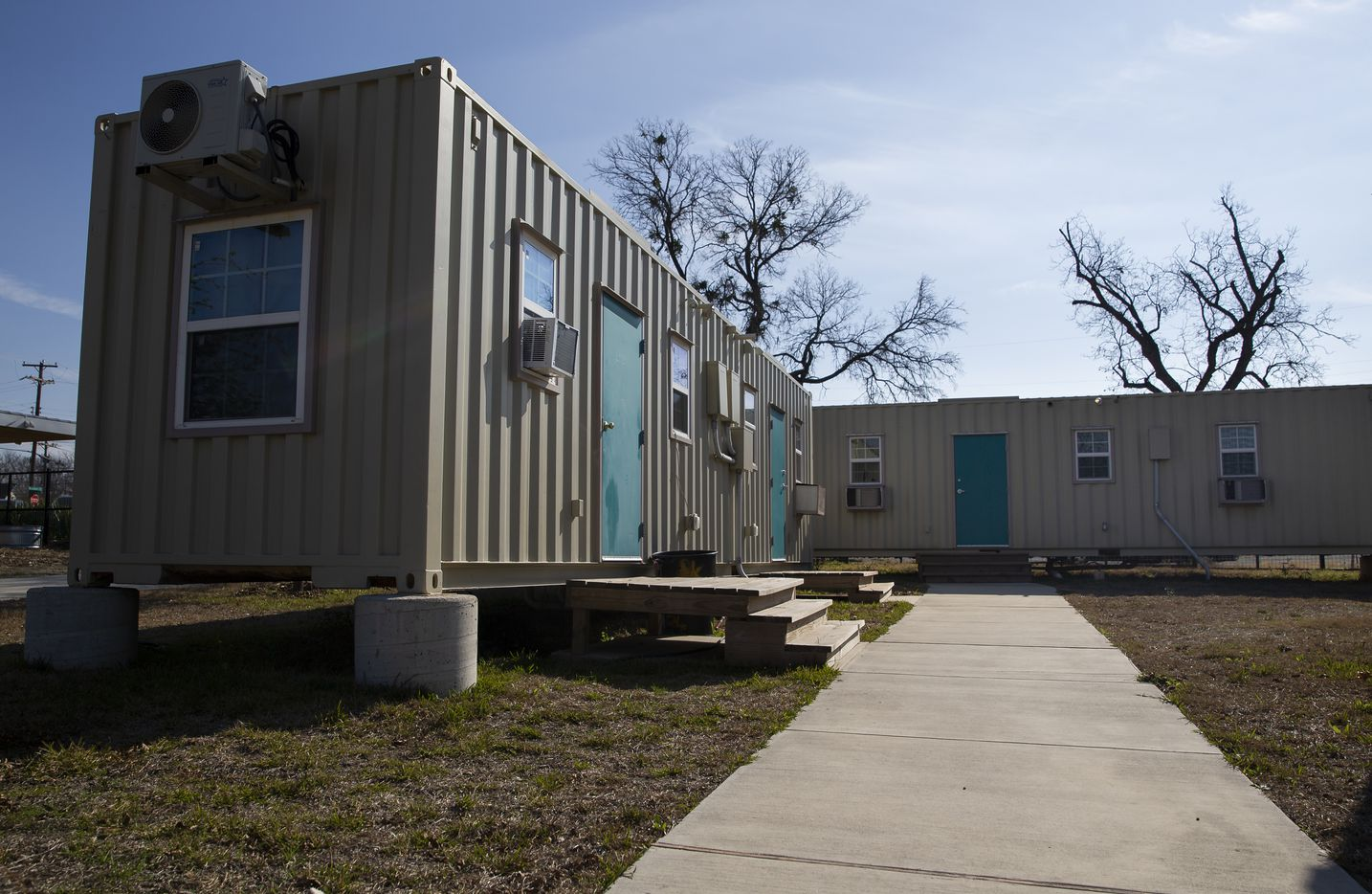 Recycled shipping container homes at the Cottages at Hickory Crossing, which is located at 1621 S Malcolm X Blvd, on Dec. 6, 2019 in Dallas. Hickory Cottages, a project administered by nonprofit CitySquare, is a community of 50 micro-houses designed to provide housing for homeless individuals. (Juan Figueroa/ The Dallas Morning News)
