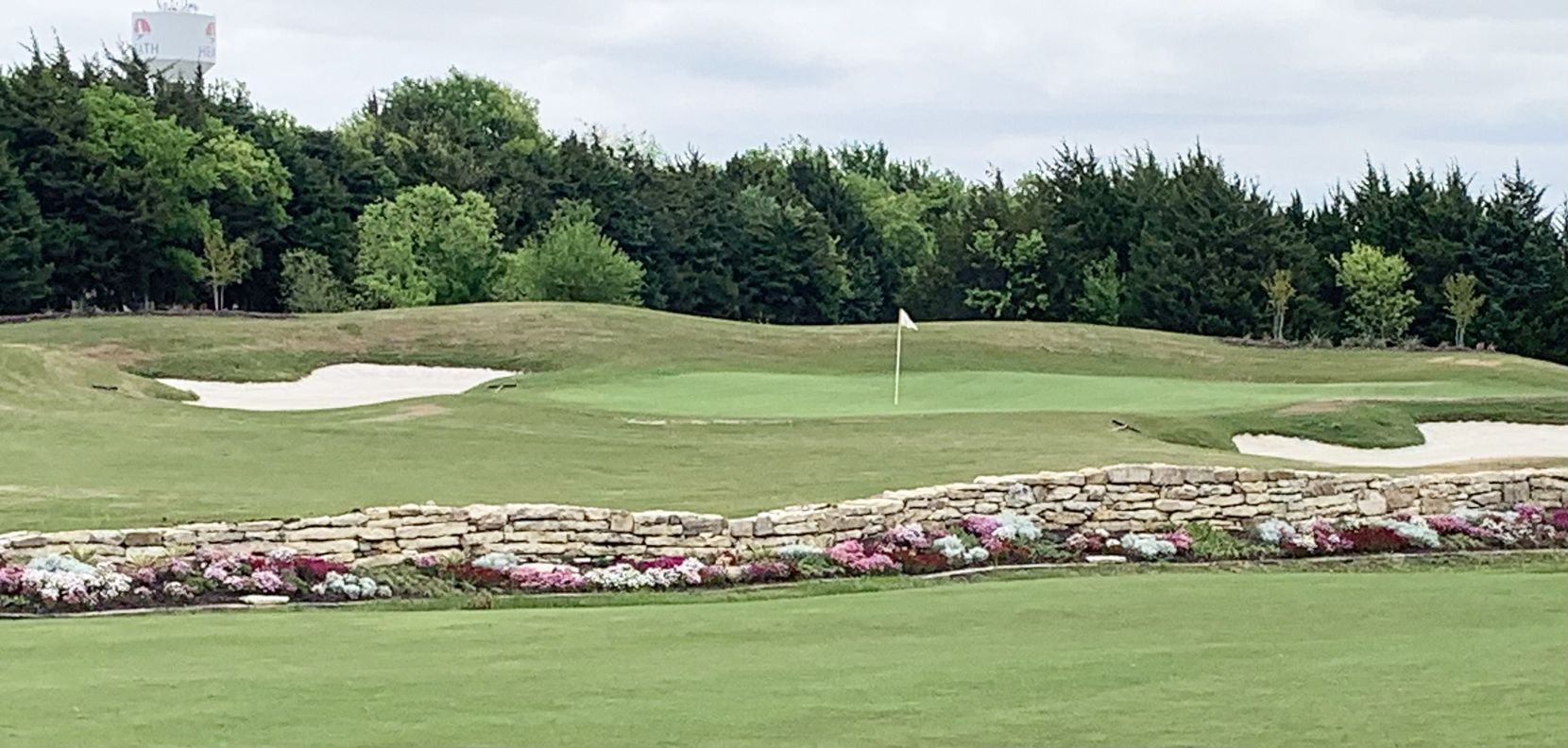 No. 5 at Heath Golf and Yacht Club in Heath, Texas, is a 186-yard par 3 from the tips. It features a crossing penalty area with a wall and decorative plants. This is for Texas Golf 2021 on May 9, 2021.