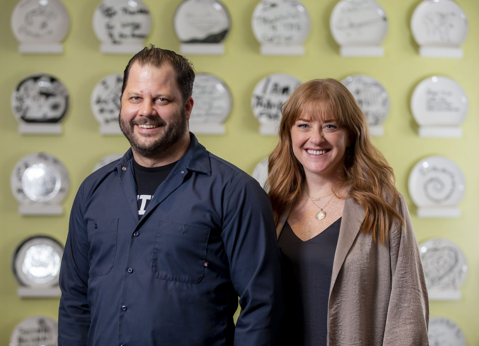 """Chad Houser, owner of Café Momentum, and Olivia Cole, Momentum Advisory Collective chief marketing officer, at the restaurant. Houser says the work is """"all about allowing these kids to see themselves for who they truly are, not the constant labels and stereotypes that society unjustly puts on them."""""""