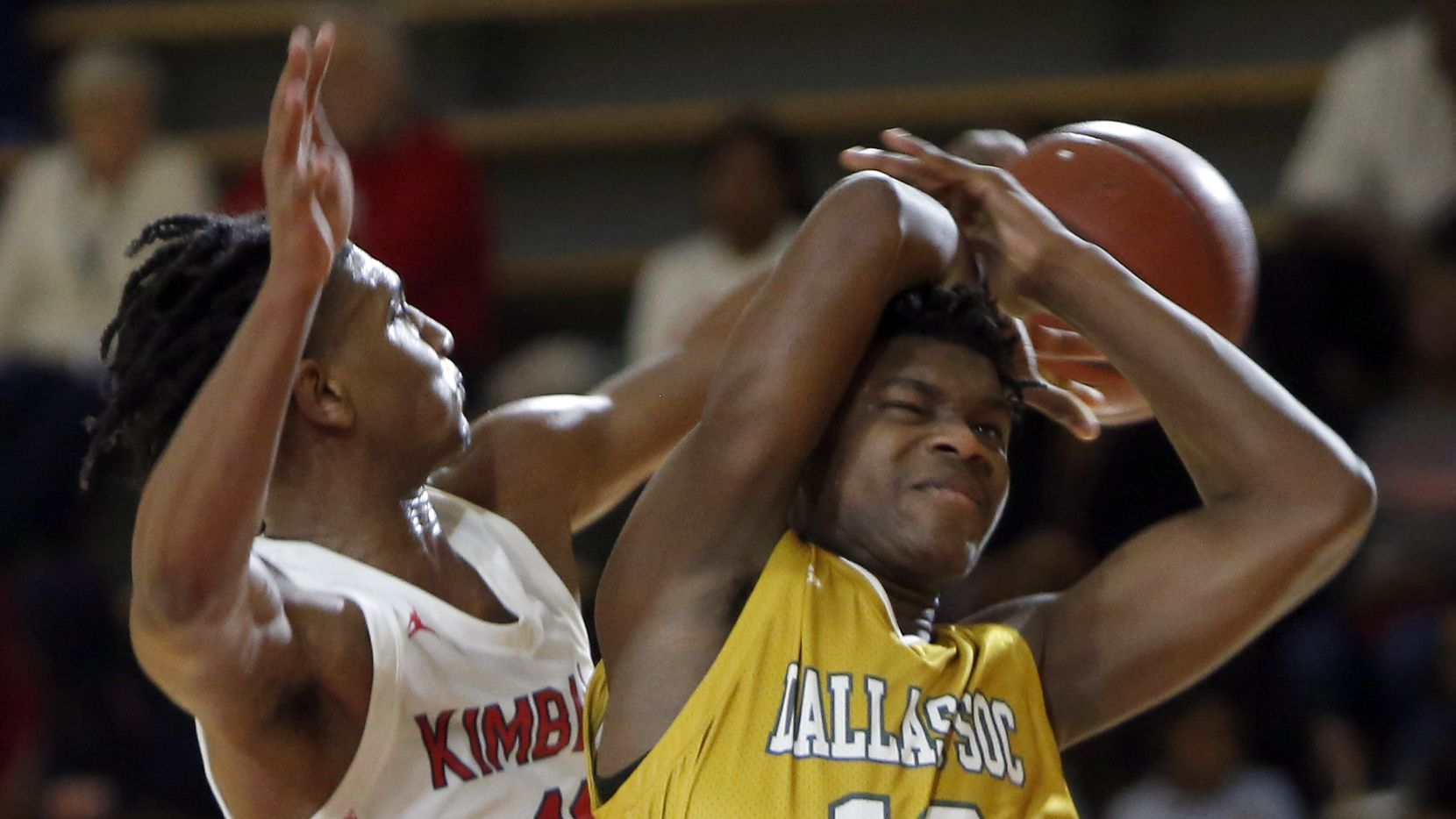 Dallas Kimball's Cory Reynolds (11) leaps to block a shot attempt by Dallas Oak Cliff's Antonio Patterson (13) during second half action. Kimball won in overtime, 75-72. The two Dallas ISD boys basketball teams played their game at Sprague Field House in Dallas on February 4, 2020.
