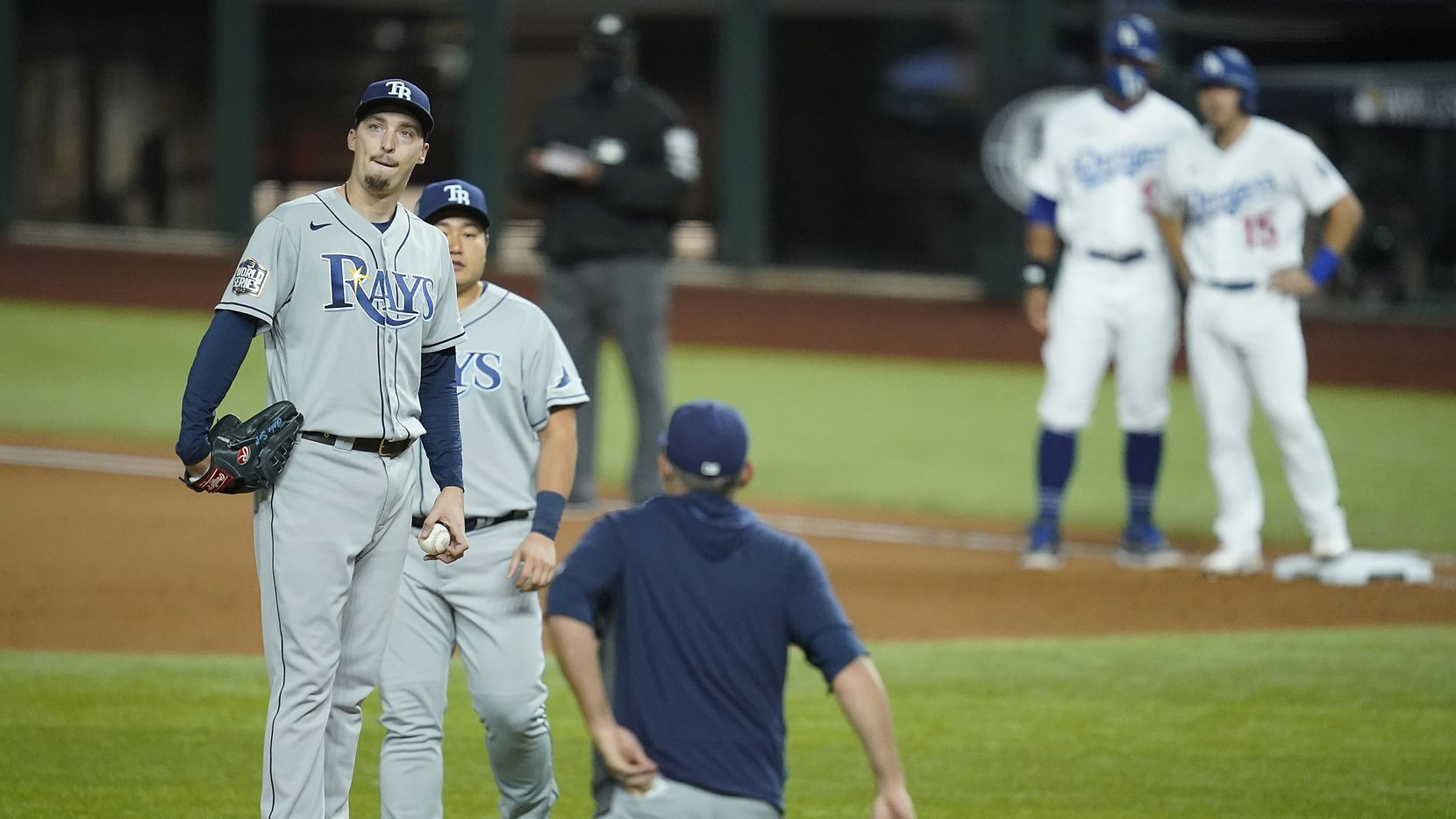 Tampa Bay Rays starting pitcher Blake Snell reacts as manager Kevin Cash comes out of the dugout to remove him from the game after giving up a base hit to Los Angeles Dodgers catcher Austin Barnes (15), only the second hit of the game for the Dodgers, during the sixth inning in Game 6 of the World Series at Globe Life Field on Tuesday, Oct. 27, 2020.
