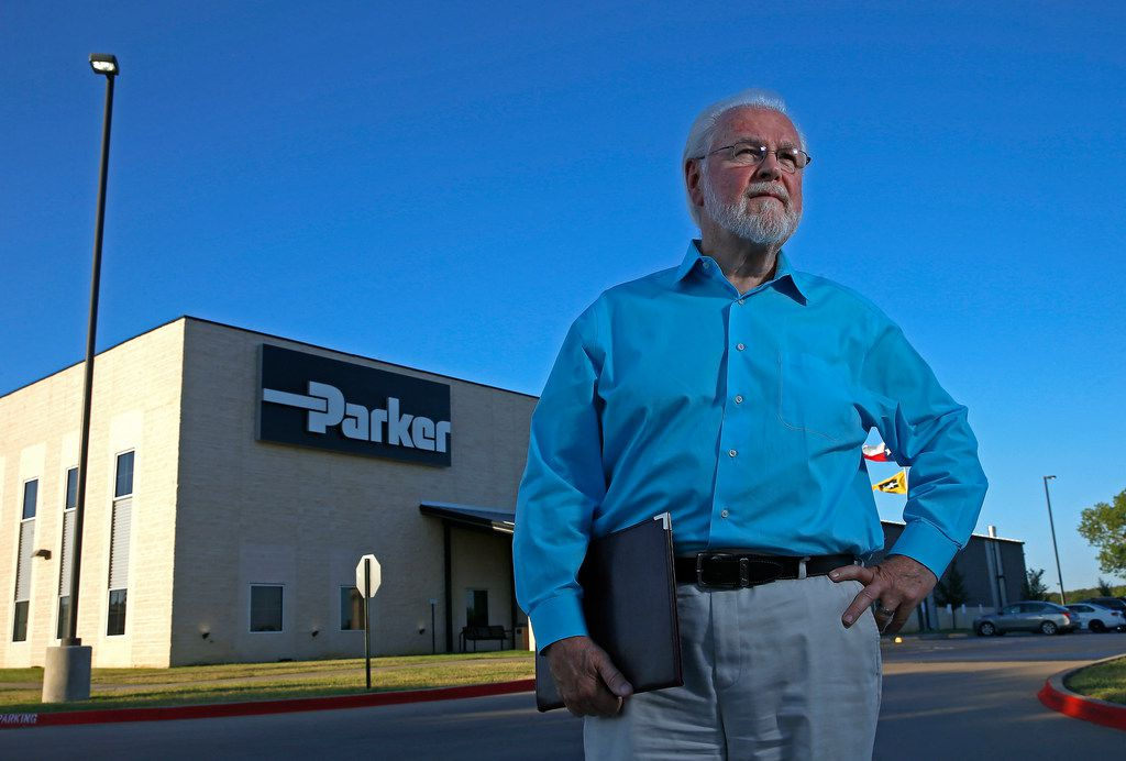 Steve Butcher, director of the Mineral Wells/Palo Pinto County Area Growth Council, poses for a photograph in front of the Parker company at Marney Dunman Perry Jr. Technology Center in Mineral Wells.