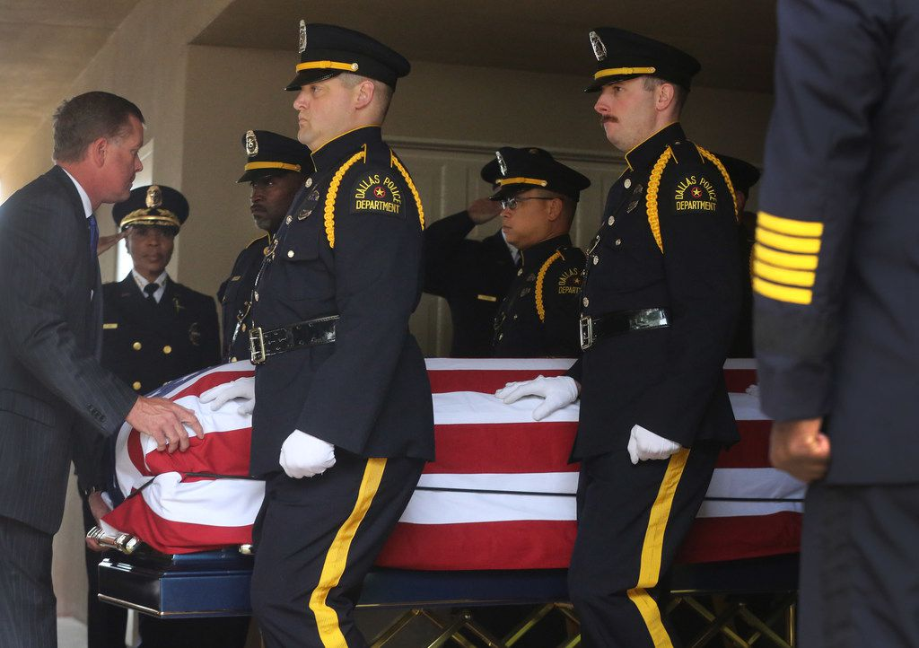 The casket of Officer Rogelio Santander is carried to the hearse after the funeral at Lake Pointe Church in Rockwall.