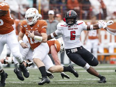AUSTIN, TX - NOVEMBER 29:  Sam Ehlinger #11 of the Texas Longhorns runs the ball defended by Riko Jeffers #6 of the Texas Tech Red Raiders in the first quarter at Darrell K Royal-Texas Memorial Stadium on November 29, 2019 in Austin, Texas.  (Photo by Tim Warner/Getty Images)