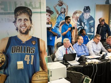 "FILE - Seated at a table from left: Mavericks assistant GM Keith Grant, director of scouting Jason White, president of basketball operations/GM Donnie Nelson, director of player personnel Tony Ronzone and assistant VP of basketball operations Michael Finley huddle in the team's ""war room"" during the 2017 NBA draft at American Airlines Center on Thursday, June 22, 2017, in Dallas."