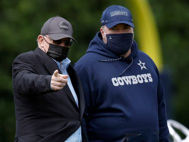 Dallas Cowboys owner Jerry Jones (left) and head coach Mike McCarthy visit on the sidelines as the rookies walk through the minicamp at The Star in Frisco, Texas on Friday, May 14, 2021.