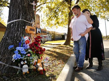 The parents of 14 year-old John Zuniga, Osvaldo and Graciela Zuniga, visit a memorial for their slain son on Texas Dr. in Dallas, Sunday, November 15, 2020.  Over the summer, John was killed here a block away from their home during a drug deal involving $55 of marijuana. A grand jury recently declined to indict 2 out of 3 suspects in the case. (Tom Fox/The Dallas Morning News)