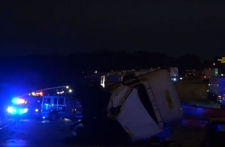 An 18-wheeler lies on its side after it was involved in a wreck with another vehicle that left three dead Wednesday morning in Pleasant Grove.