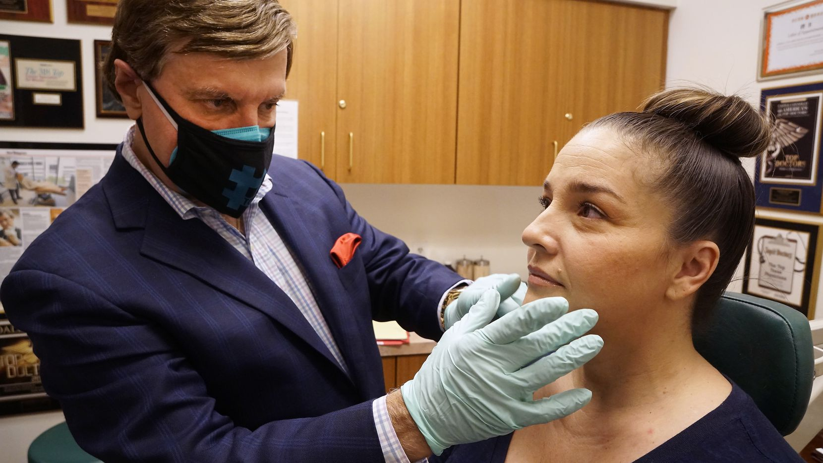 Dr. Rod J. Rohrich does a follow-up to inspect Jennifer Smith's face fillers at his office in Dallas on Monday. Rohrich said Botox has been a popular procedure during the pandemic as people want to get rid of wrinkles they're spotting while on Zoom calls.