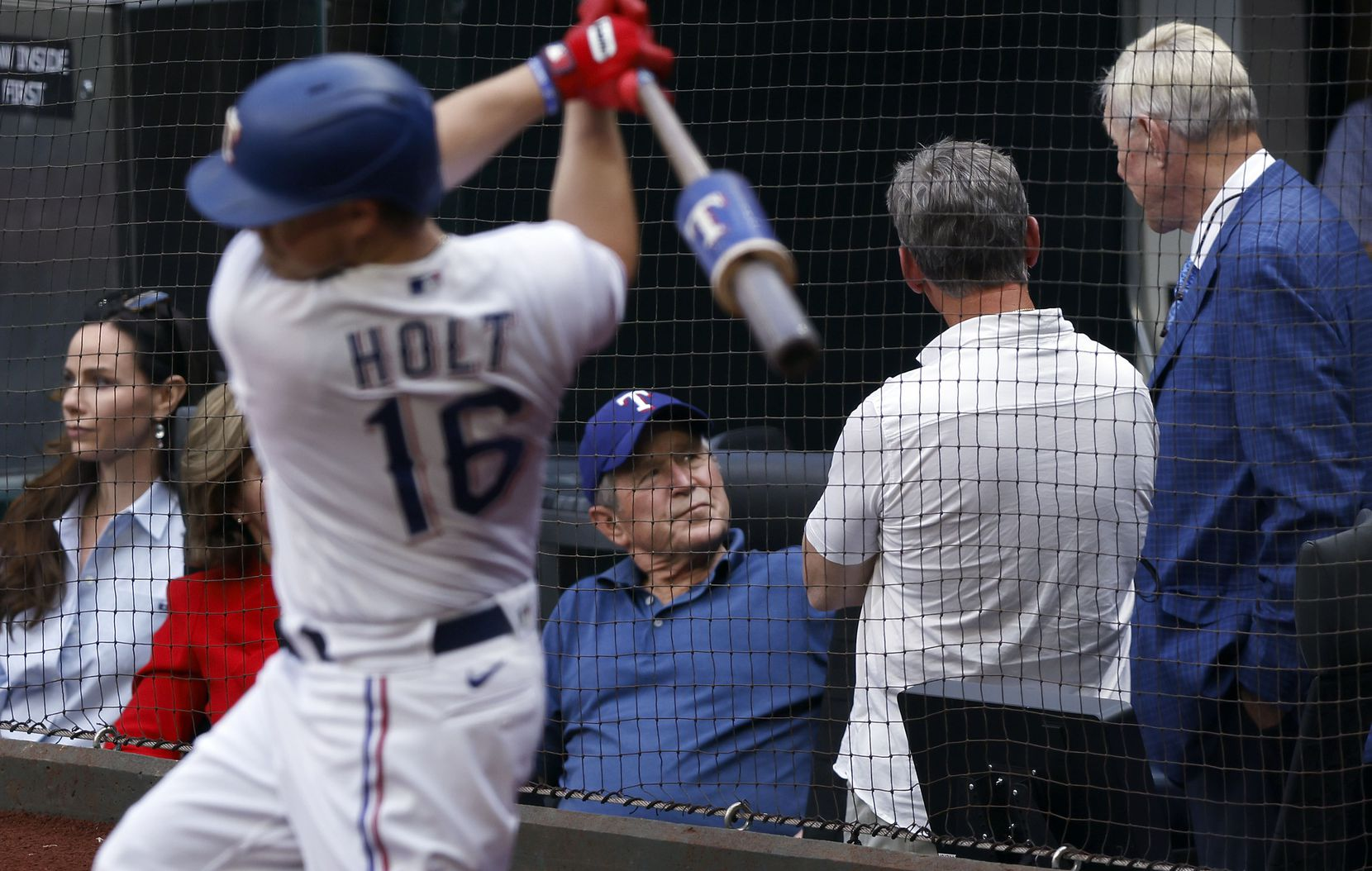 Former President George W. Bush (center) visits with former Houston Astros player Craig Biggio (center) and Rangers co-owner Ray Davis during Opening Day at Globe Life Field in Arlington, Monday, April 5, 2021. Biggio was at the game to see his son, Toronto Blue Jays Cavan Biggio. The Texas Rangers were facing the Toronto Blue Jays in their home opener. (Tom Fox/The Dallas Morning News)