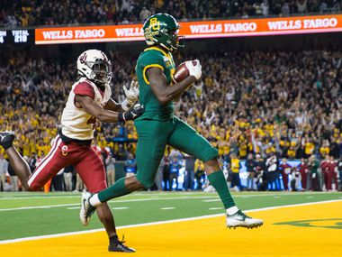 FILE - Baylor wide receiver Denzel Mims (5) runs to the end zone for a touchdown ahead of Oklahoma cornerback Jaden Davis (4) during the first quarter of a game on Saturday, Nov. 16, 2019, at McLane Stadium in Waco.
