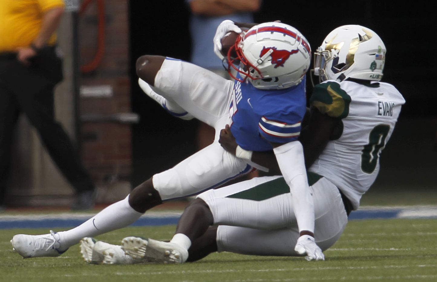 SMU receiver Danny Gray (5), left, gains yardage before he is tackled by South Florida cornerback Daquan Evans (0) following a first quarter reception. The two teams played their NCAA football game at SMU's Ford Stadium in Dallas on October 2, 2021. (Steve Hamm/ Special Contributor)