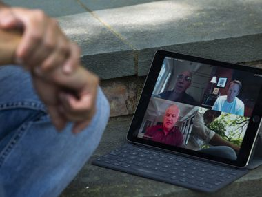 The pandemic has forced many workers to use technology to stay connected, and executives are divided over the effectiveness of remote work. Last spring, Adam Blumenfeld of Varsity Brands participated in a Zoom meeting outside his Dallas home.