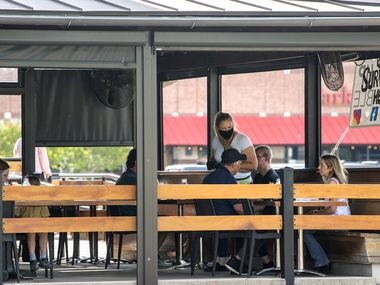 Patrons dine on the outdoor patio at Whiskey Cake Kitchen & Bar on May 1.