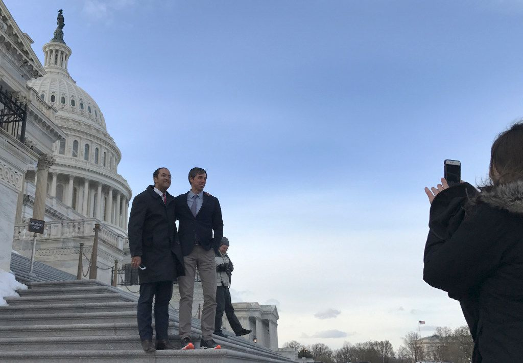 Rep. Will Hurd, R-Texas, left, Rep. Beto O'Rourke, D-Texas., pose for a photo at the U.S. Capitol Wednesday evening, March 15, 2017, on Capitol Hill in Washington. Nearly 36 hours after it started, the bipartisan road trip has ended and the two Texas congressmen are back at work in Washington. (AP Photo/Mary Clare Jalonick)