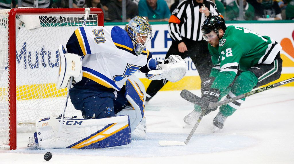 St. Louis Blues goaltender Jordan Binnington (50) deflects a shot as Dallas Stars center Radek Faksa (12) looks to shoot the rebound during the first period at the American Airlines Center in Dallas, Sunday, May 5, 2019. The teams were playing Western Conference Second Round Game 6 of the 2019 NHL Stanley Cup Playoffs. (Tom Fox/The Dallas Morning News)