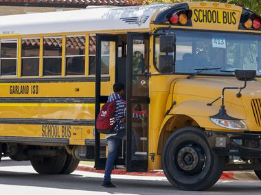 Students board a Garland ISD bus outside Garland High School on Friday. The district will share any updates from Tuesday night's board meeting via social media and other communication channels, district spokesperson Caren Rodriguez wrote in an email.