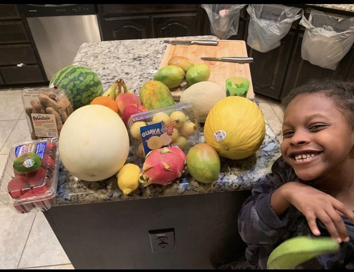 E'Syntheis Chambers, 7, is seen with fruits that make his business successful.