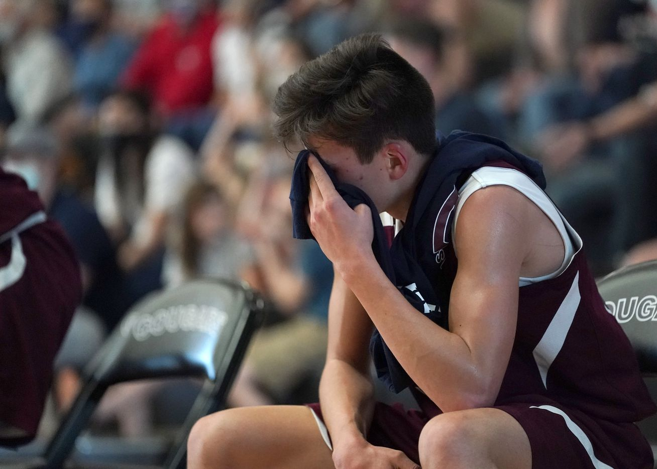 Irving Faustina's Ben Nelson (33) covers his face after coming off the court late in the fourth quarter against Cypress Covenan during the TAPPS 1A boys basketball championship game at College Station High School in College Station, Texas on Saturday, March 13, 2021. Faustina would go on to lose the game 50-37. (Sam Craft/Special Contributor)