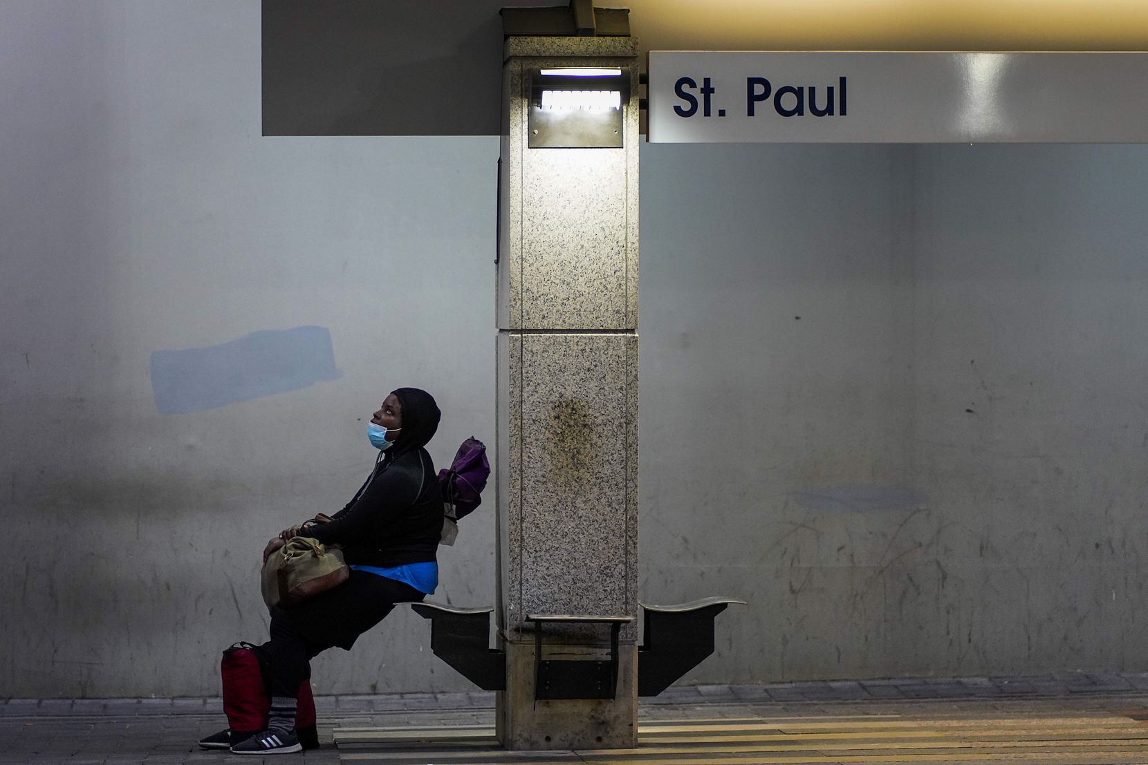 A passenger wearing a protective face mask waited for a train at the DART rail St. Paul Station in downtown Dallas on May 9, 2020.