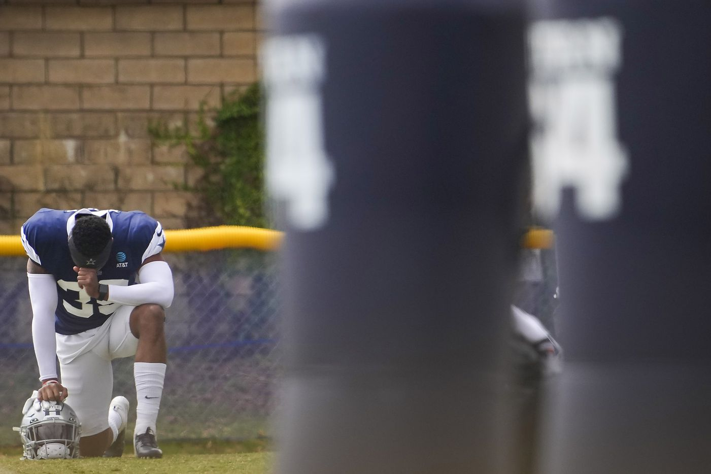 Dallas Cowboys safety Tyler Coyle takes a knee before a practice at training camp on Wednesday, July 28, 2021, in Oxnard, Calif.